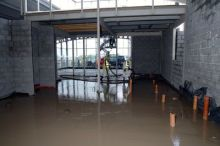 Liquid screed floor, prior to dappling, of a new fast food outlet under construction.