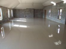 The screeded floor, after dappling, of the church.